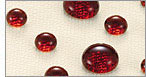 Drops of red liquid on fabric