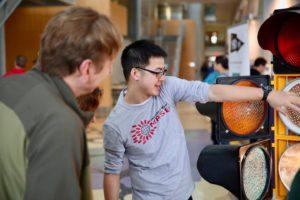 Volunteers explain science at engineering expo