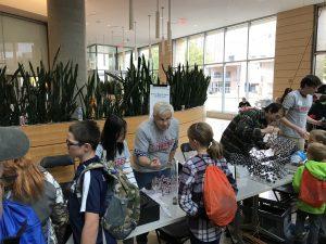 Wisconsin Science Festival Volunteers explaining science