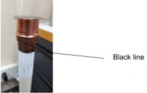 Copper lens with black line highlighted